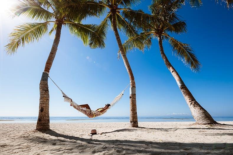 Person in hammock on beach